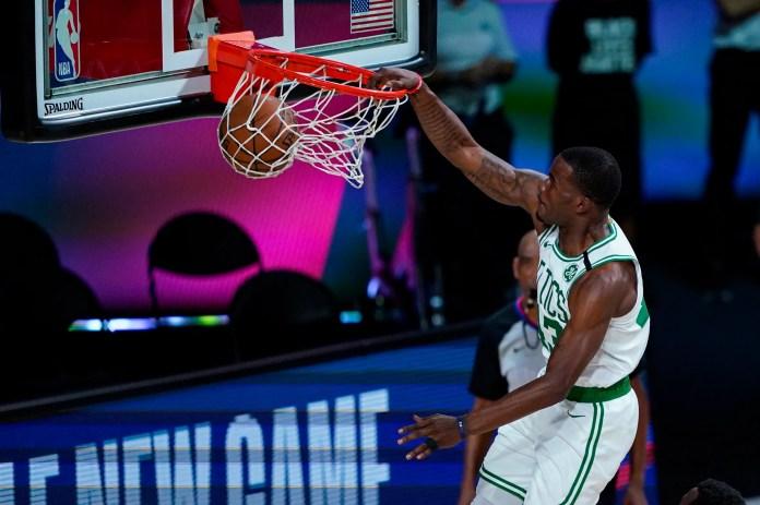 Aug. 5: Boston Celtics guard Javonte Green dunks against the Brooklyn Nets.
