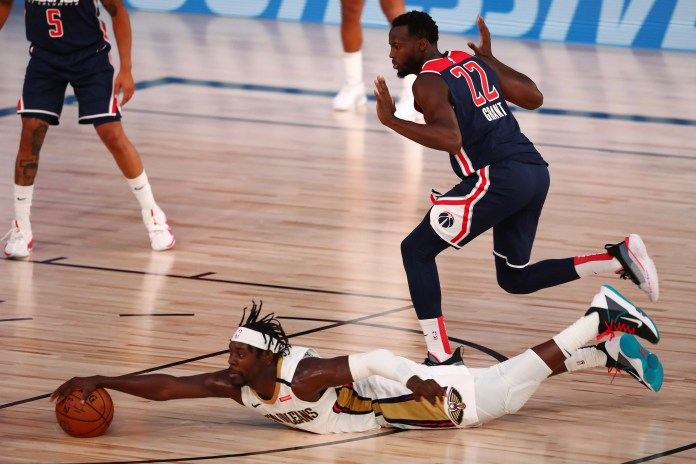 Aug. 7: Pelicans guard Jrue Holiday goes all-out trying to get to a loose ball against the Wizards.