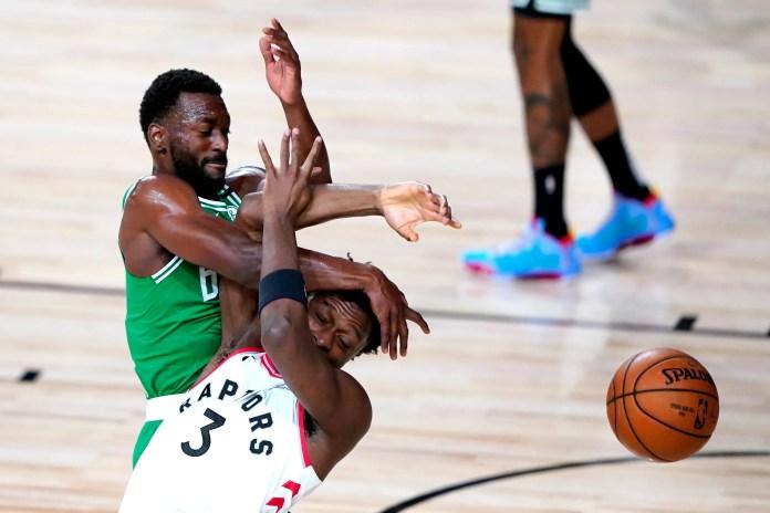 Aug. 7: Celtics guard Kemba Walker collides with Raptors forward OG Anunoby.