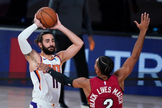 Aug 8, 2020; Lake Buena Vista, Florida, USA; Phoenix Suns' Ricky Rubio (11) looks to pass as Miami Heat guard Gabe Vincent (2) defends during the second half of an NBA basketball game at Visa Athletic Center. Mandatory Credit: Ashley Landis/Pool Photo-USA TODAY Sports