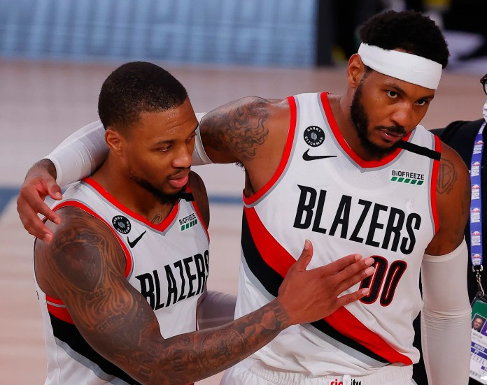 Aug. 9: Damian Lillard and Carmelo Anthony leave the floor after the Blazers' big win over the Sixers.