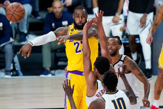 Aug. 10: The Los Angeles Lakers' LeBron James (23) passes the ball against the Denver Nuggets. The Lakers won the game, 124-121.