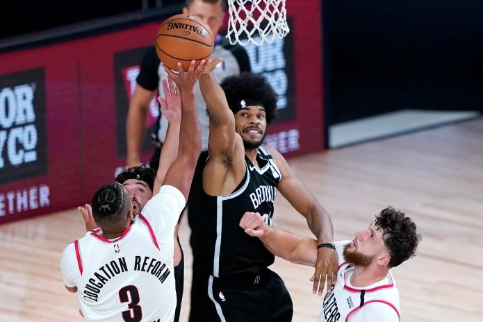 Aug. 13: The Brooklyn Nets' Jarrett Allen attempts to block a shot from the Portland Trail Blazers' CJ McCollum. The Blazers won the game, 134-133.