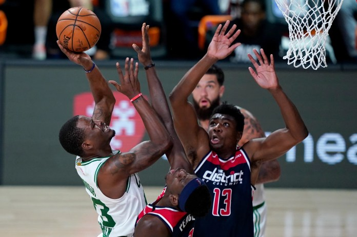 Aug. 13: The Boston Celtics' Javonte Green heads to the basket against the Washington Wizards' Isaac Bonga and Thomas Bryant (13). The Wizards won the game, 96-90.