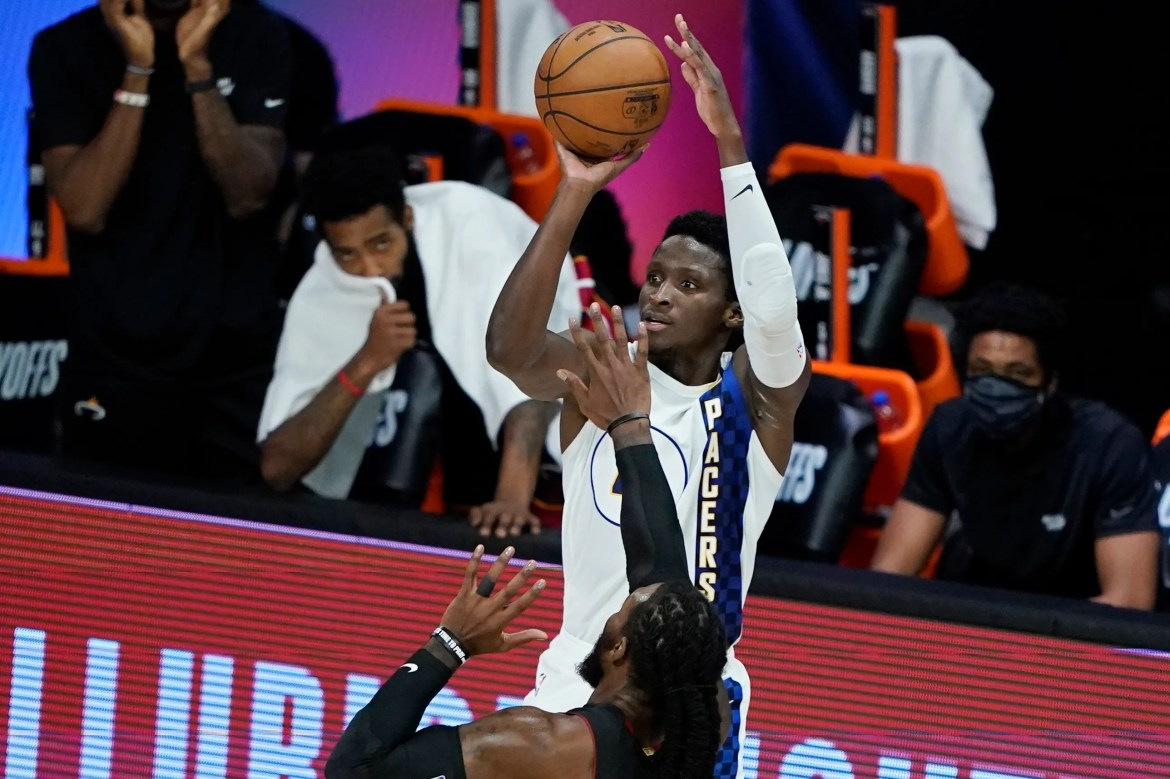 Victor Oladipo (4) of the Indiana Pacers shoots against the Miami Heat during the first half of an NBA basketball first-round playoff game on Monday, August 24, 2020, in Lake Buena Vista, Florida.