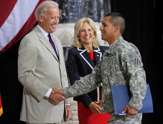 oe Biden, then vice president, shakes hands with a U.S. Army soldier after his swearing-in at a naturalization ceremony at al-Faw Palace in Baghdad, Iraq, July 4, 2010.