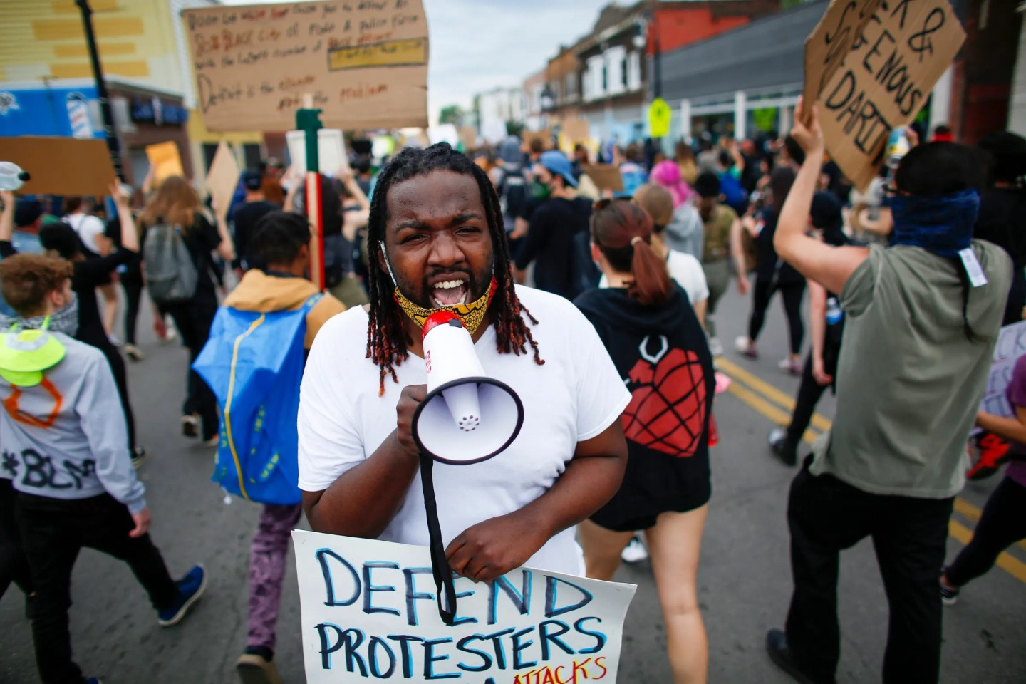 "A demonstrator shouts the protest chant, ""hands up, don't shoot,"" as he and other protesters march through southwest Detroit to protest police brutality and the death of George Floyd on Monday, June 1, 2020."