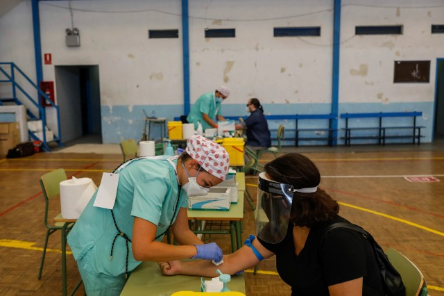 Teachers and auxiliary staff take COVID-19 tests in Madrid, Spain, Thursday, Sept. 3, 2020. The Madrid region is a coronavirus hot spot, with almost 32,000 new cases officially recorded over the past two weeks. The tests are mandatory for school employees.