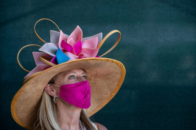Whitney Byars wears a Christine Moore designed hat to the Kentucky Derby at Churchill Downs on Sept. 5, 2020.