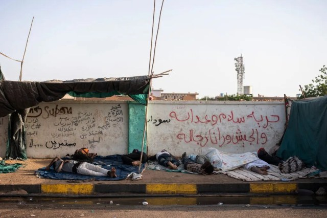 Protestors sleep in the early in the morning before today's protests against the military junta on April 27, 2019 in Khartoum, Sudan.