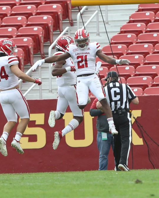 Louisiana-Lafayette running back Chris Smith (21) celebrates after returning a kickoff for a touchdown against Iowa State.