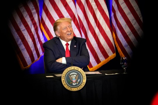 President Donald Trump smiles during a Latinos for Trump Coalition roundtable Sunday in Las Vegas.