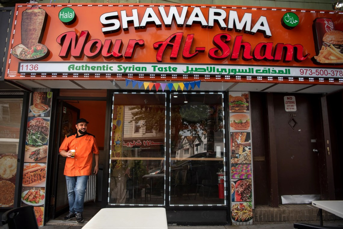 Syrian refugees  Samir Alkhawaldah, pictured, Mohammad Hlal and Diyaa Khatib celebrated the opening of their restaurant Nour Al-Sham on Main St. in Paterson on September 14, 2020. Samir takes a quick break after the lunch rush on their first day open.