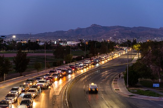 Almost a mile from the border, thousands of vehicles wait to cross into the United States before sunrise in Ciudad Juárez, Mexico on Sept. 23, 2020.