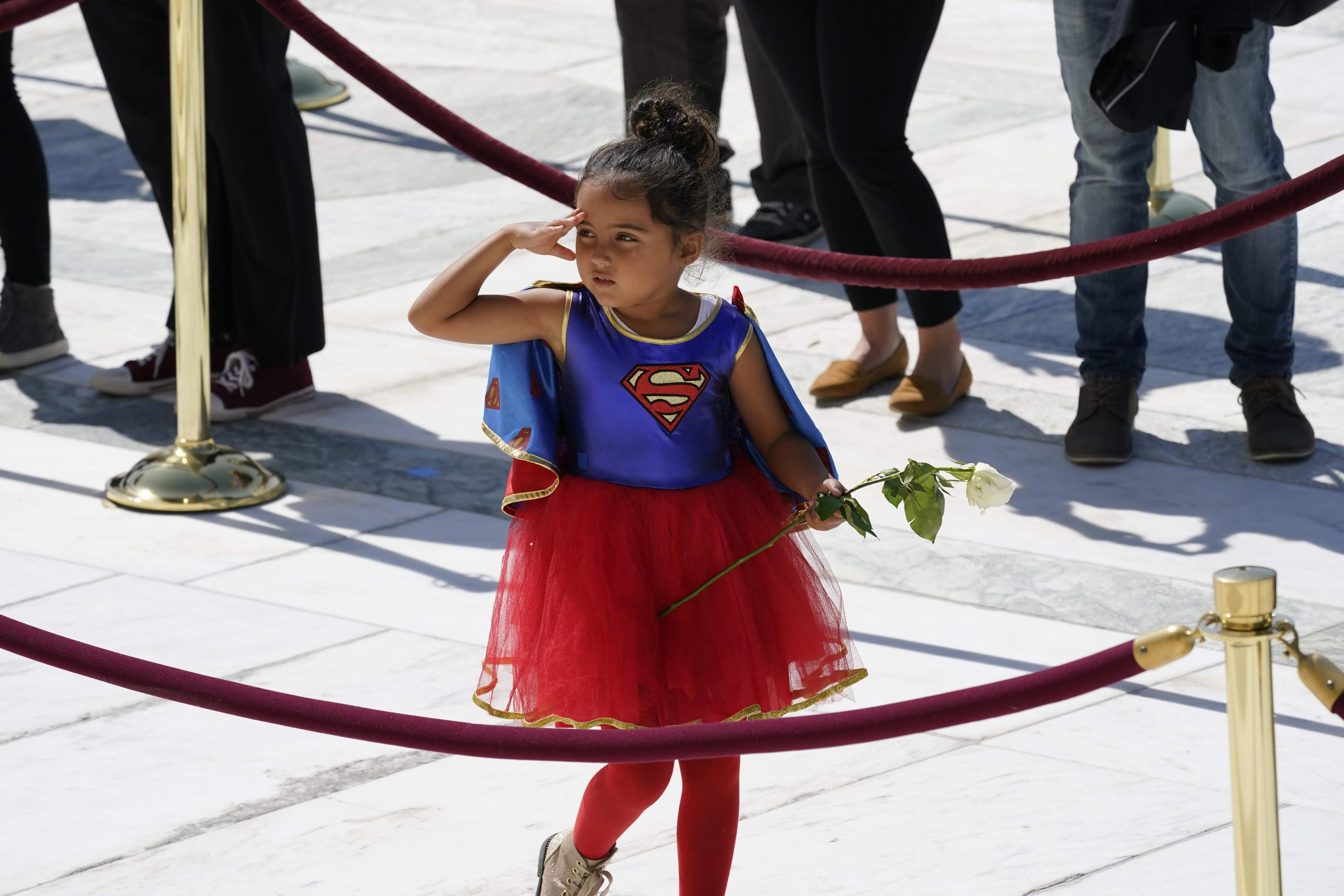 A child in a Supergirl costume pays respects as Associate Justice Ruth Bader Ginsburg lies in repose in front of the U.S. Supreme Court in Washington, D.C., on Sept. 23.