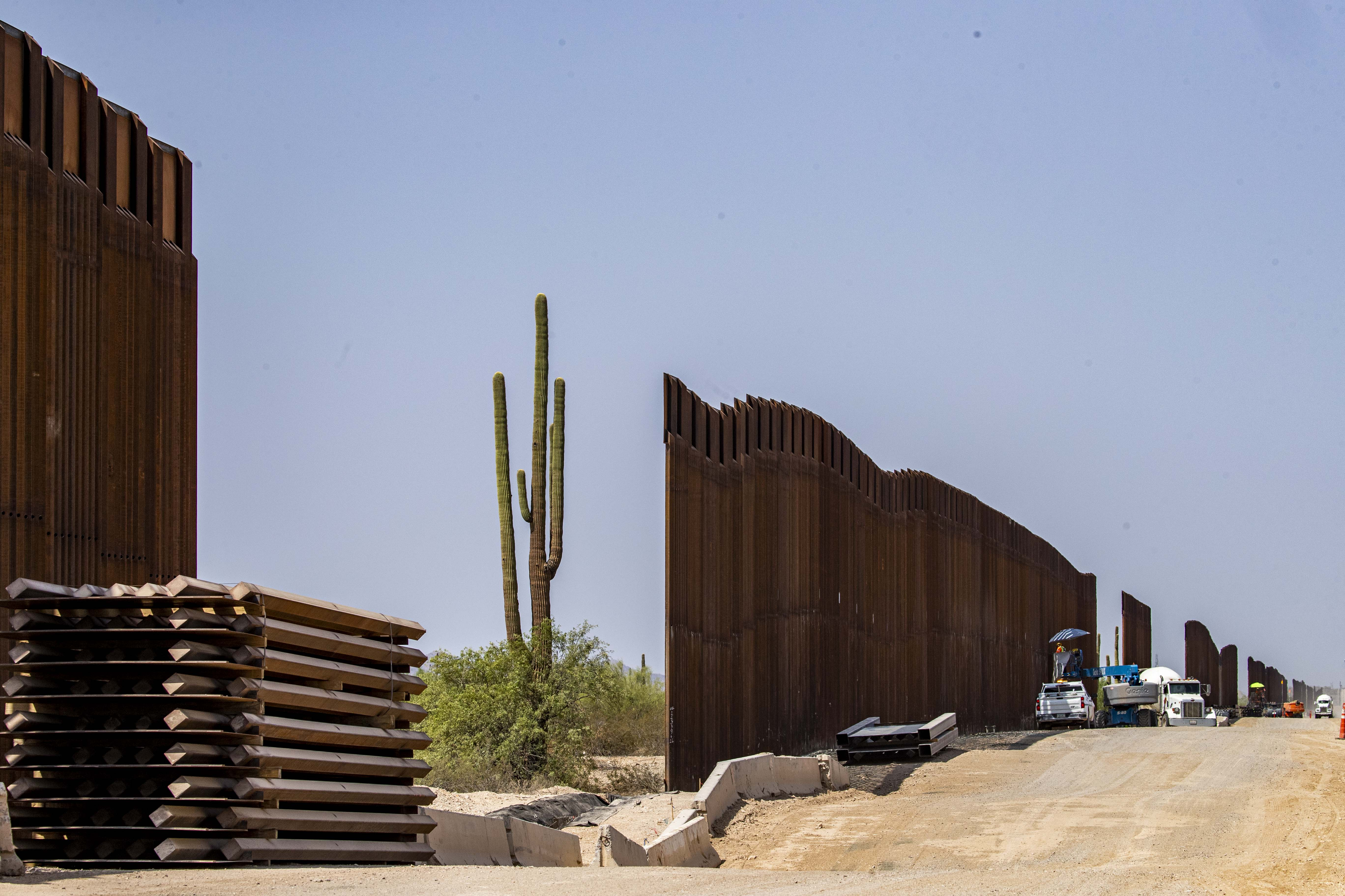 Construction workers installing 30-foot steel bollards at Organ Pipe Cactus National Monument in southern Arizona are accused of dumping metal and other leftover construction materials across the border into Mexico, where residents of the border city of Sonoyta, Sonora gather those materials and sell them for scraps to make ends meet.