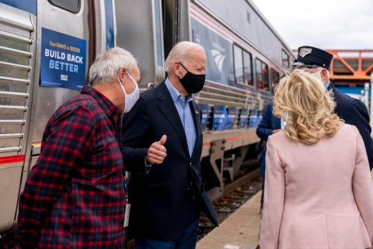 Democratic presidential nominee Joe Biden gives a thumbs up after speaking to supporters before boarding his train with his wife Jill Biden, right, at Amtrak's Cleveland Lakefront train station on Sept. 30, 2020.