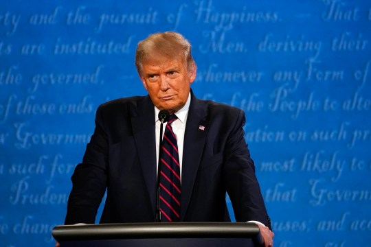 President Donald Trump listens during the first presidential debate with Democratic presidential candidate former Vice President Joe Biden Tuesday, Sept. 29, 2020, at Case Western University and Cleveland Clinic, in Cleveland.