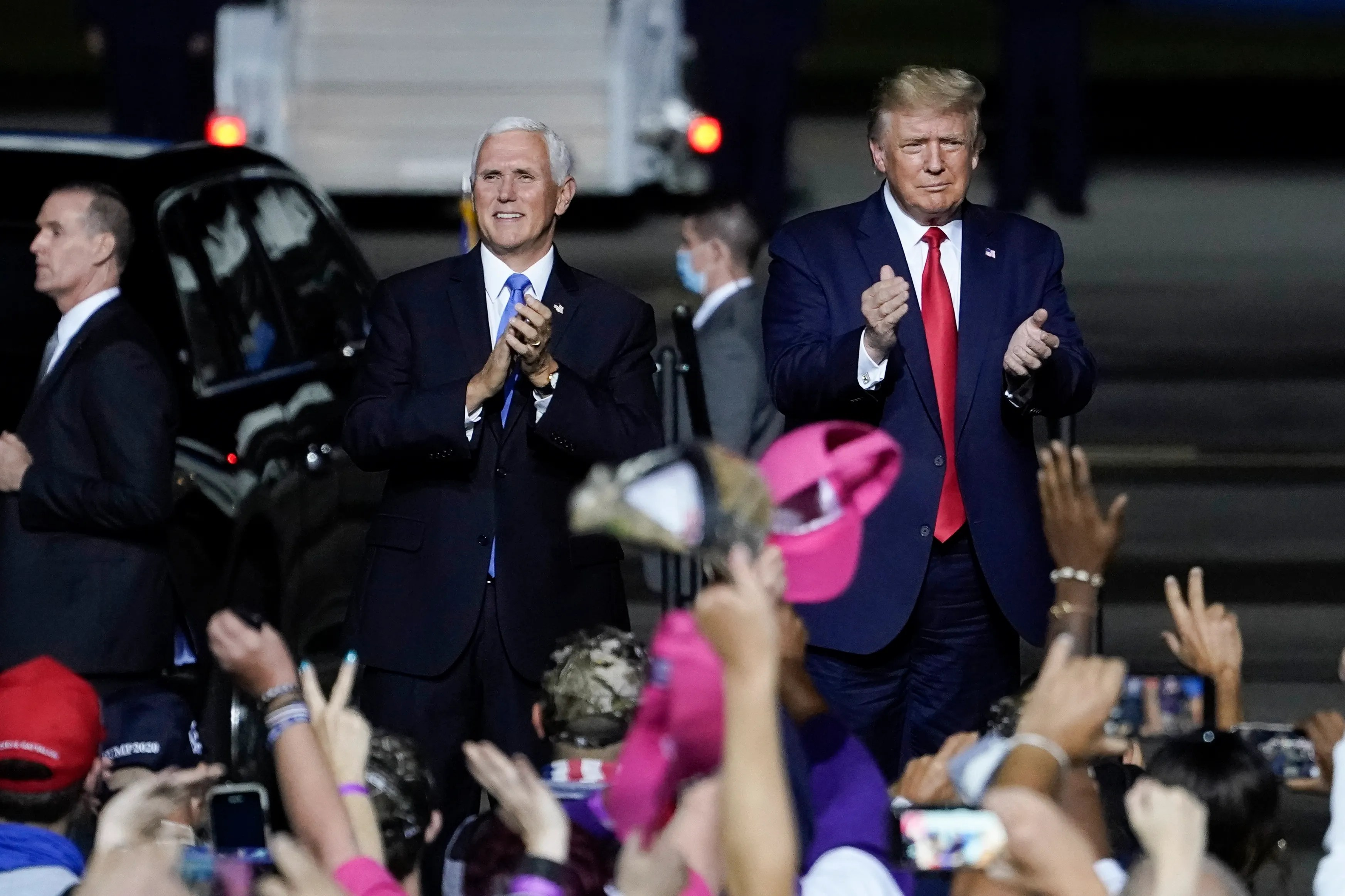 President Trump and Vice President Pence arrive for a campaign rally at Newport News/Williamsburg International Airport on Sept. 25, 2020 in Newport News, Va.