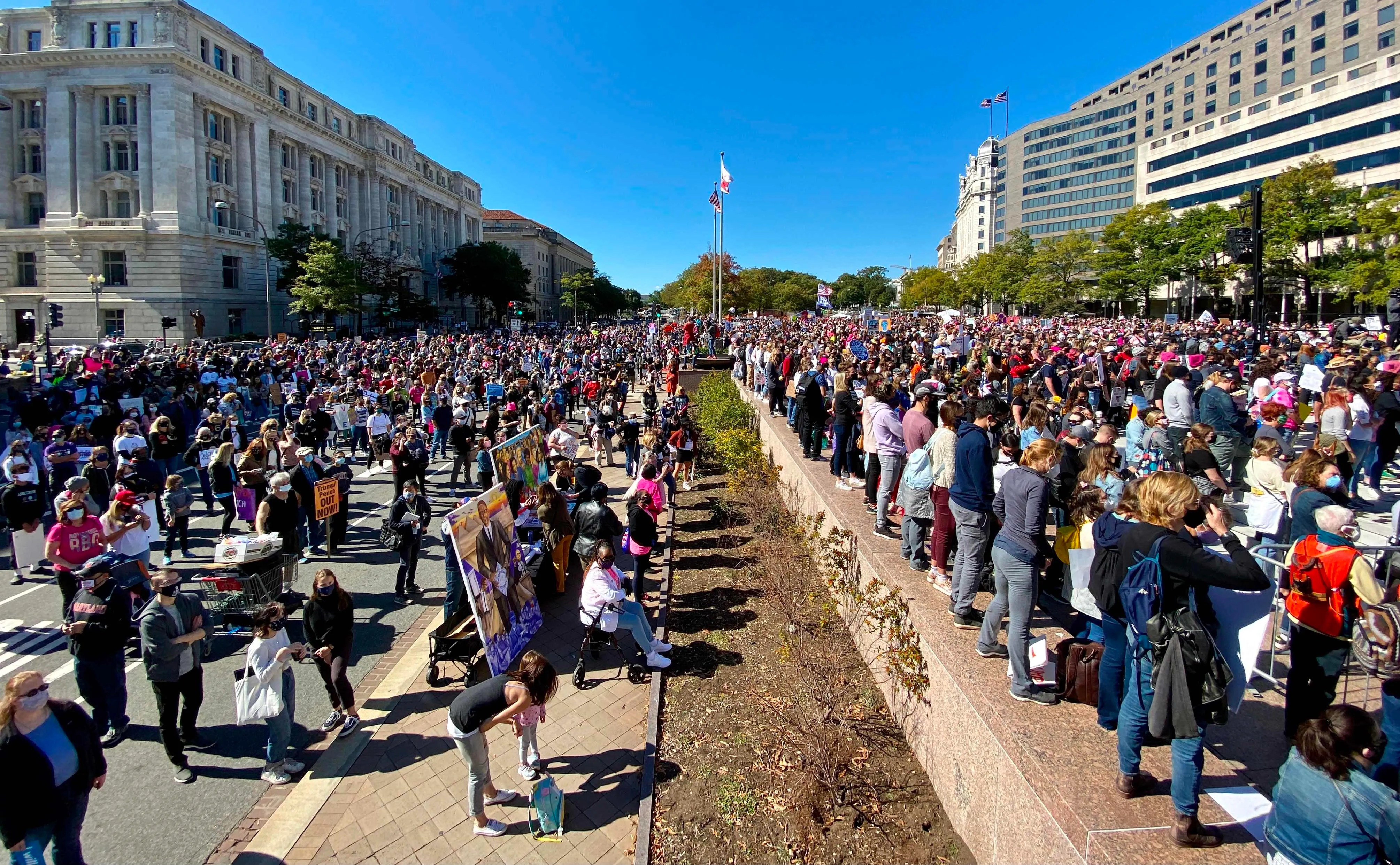 Demonstrators gather to take part in the nationwide Women's March on October 17, 2020, at Freedom Plaza in Washington, DC.