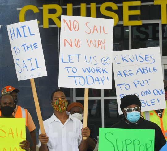 Members of the International Longshoremen's Association and other workers rallied last week outside Port Canaveral's Cruise Terminal 1, seeking an end to the federal government's no-sail order for cruise lines.