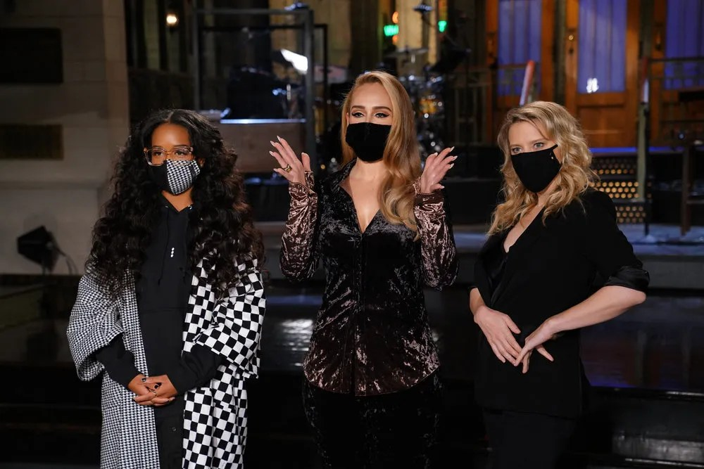 'Saturday Night Live' host Adele, center, appears with musical guest H.E.R., left, and Kate McKinnon before the Oct. 24 episode.