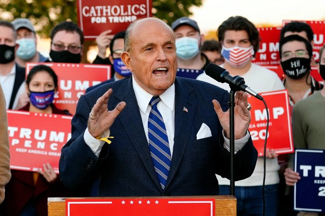 Conspiracies, cigars, and ink-stained palms: Giuliani's bizarre video