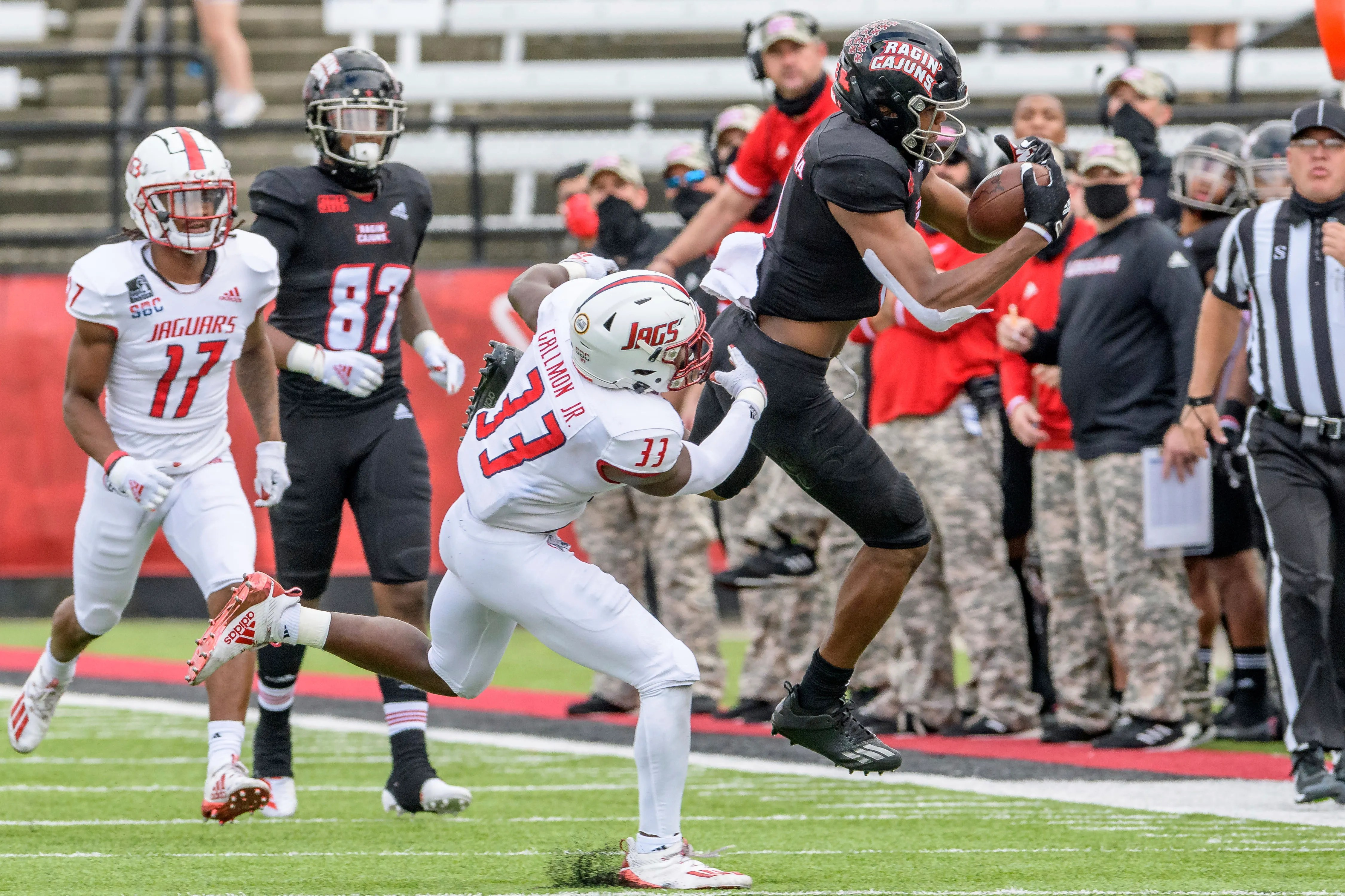With Peter LeBlanc out, freshman receiver Kyren Lacy (right, in black), shown here making a catch in a win over South Alabama earlier this month, steps into a bigger role for the Ragin' Cajuns at UL Monroe on Saturday.