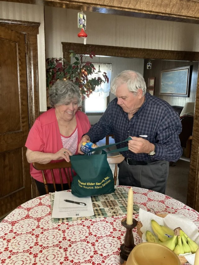 Couple Madeline and Joseph Dias check out grocery delivery from Bristol County Elder Services food security program. They say they don't mind staying home during the pandemic.