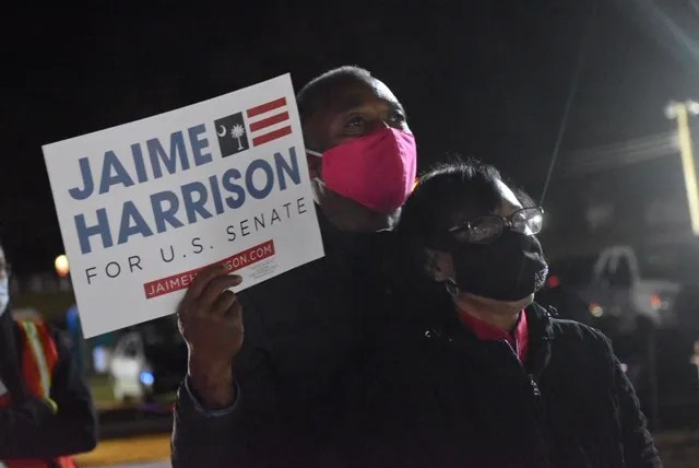 """James and Andria Jeffries attended a campaign rally Nov. 2, 2020 in Orangeburg, South Carolina. The Jeffries said many voters waited for Clyburn's endorsement. """"He's honest and people trust him,""""  Andria Jeffries said."""