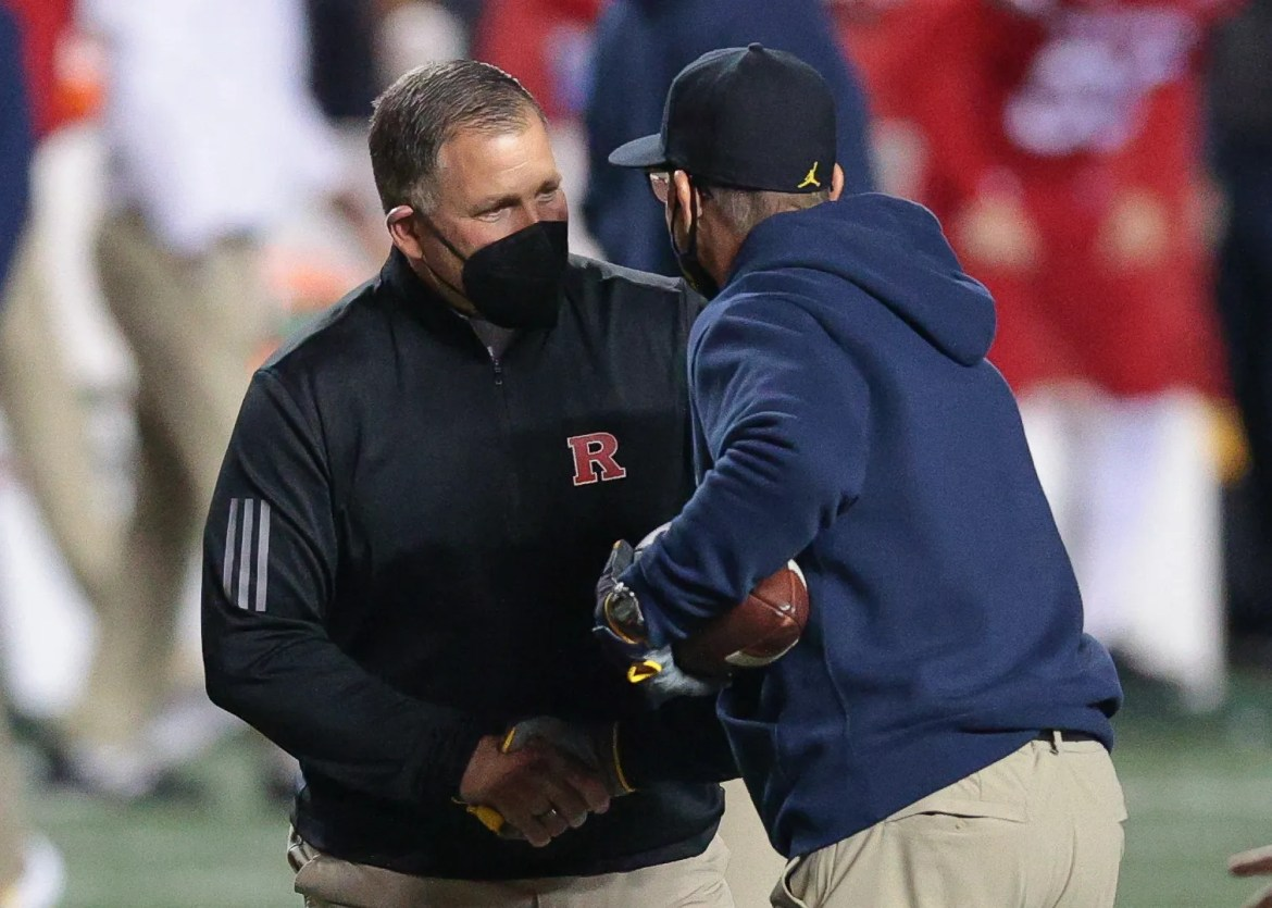 Rutgers Scarlet Knights head coach Greg Schiano, left, shakes hands with Michigan Wolverines head coach Jim Harbaugh before their game at SHI Stadium.