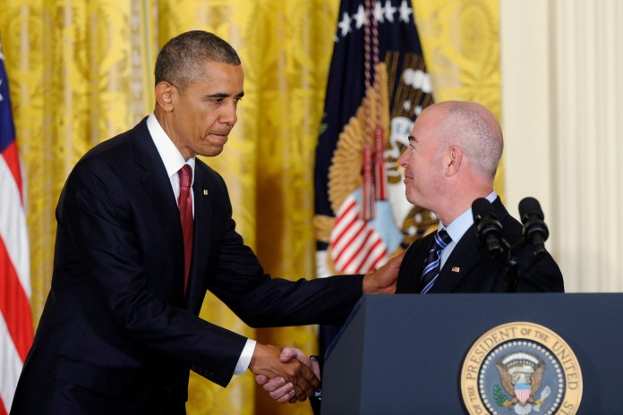 President Barack Obama shakes hands with Deputy Homeland Security Secretary Alejandro Mayorkas after he administered the oath of allegiance during a naturalization ceremony for active duty service members and civilians on July 4, 2014, in the East Room of the White House in Washington.