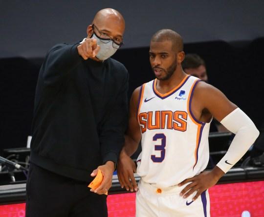 Phoenix Suns head coach Monty Williams talks with guard Chris Paul (3) during the second quarter against the Dallas Mavericks at Talking Stick Resort Arena in Phoenix Dec. 23, 2020.