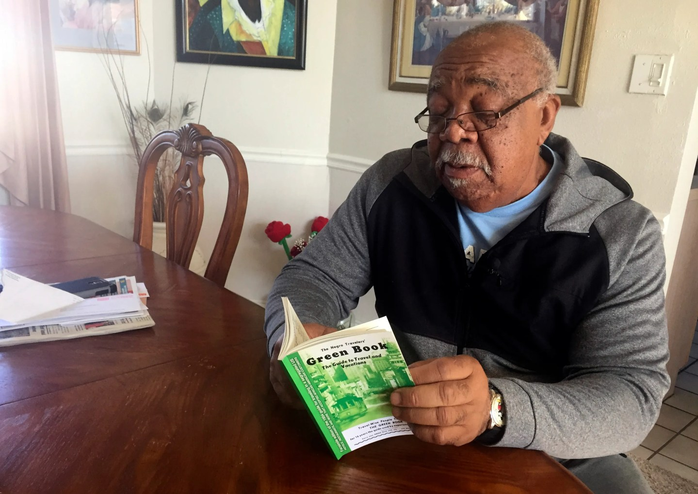 "In this Jan. 31, 2019 photo, Charles Becknell, Sr., 77, holds a copy of the 1954 edition of ""The Negro Motorist Green Book"" at his home in Rio Rancho, New Mexico."