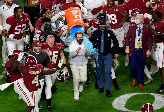 Alabama Crimson Tide head coach Nick Saban gets dunked with Gatorade after defeating the Ohio State Buckeyes in the 2021 College Football Playoff National Championship Game.