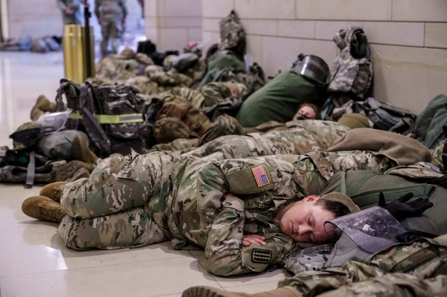 Hundreds of National Guard troops hold inside the Capitol Visitor's Center to reinforce security at the Capitol in Washington, on Wednesday.