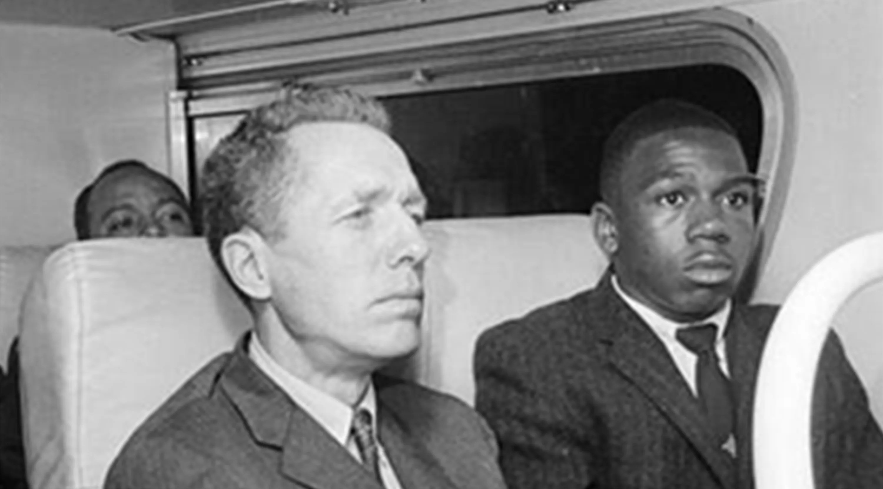 Freedom Riders Charles Person, right, and James Peck on the bus in 1961, with James Farmer, the head of CORE, in the background.