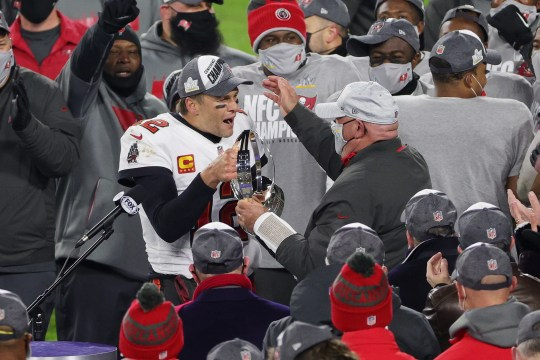 Tom Brady celebrates with coach Bruce Arians and teammates after The Bucs beat Green Bay to reach the Super Bowl.