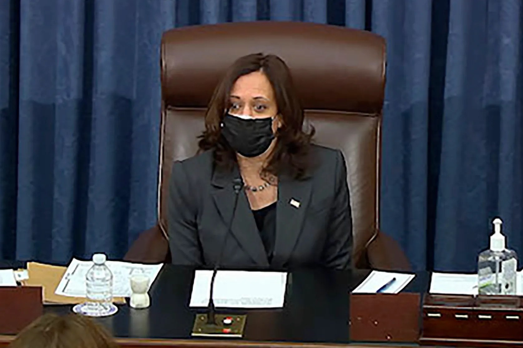 Vice President Kamala Harris sits in the chair on the Senate floor to cast the tie-breaking vote, her first, Friday, Feb. 5, 2021 at the Capitol in Washington. The Senate early Friday approved a budget resolution that paves the way for fast-track passage of President Joe Biden's $1.9 trillion coronavirus relief plan without support from Republicans.