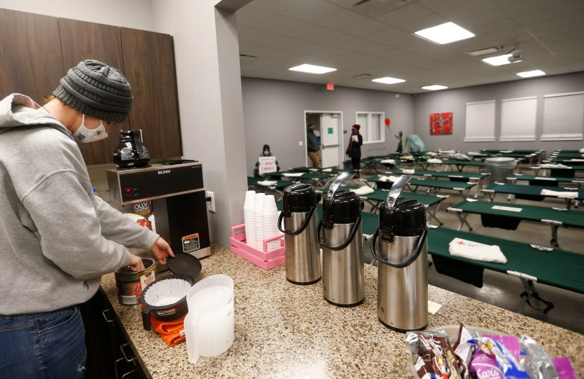 Eden Village resident Mirenda Barrows makes coffee as she volunteers in the emergency cold weather shelter set up at Eden Village on Tuesday, Feb. 16, 2021.