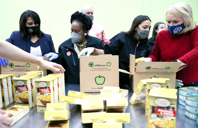 Texas congresswoman Penny Morales Shaw, from left, joins U.S. Representatives Sheila Jackson Lee, Alexandria Ocasio-Cortez and Sylvia Garcia,  as they fill boxes at the Houston Food Bank on Saturday, Feb. 20, 2021.