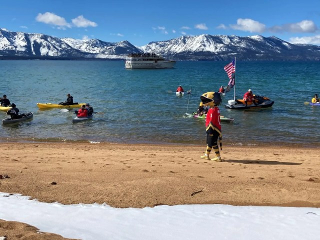 The Vegas Golden Knights mascots entertains kayakers near the beach at Edgewood Tahoe.