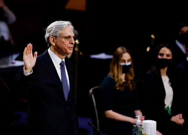 Judge Merrick Garland, nominee to be attorney general, is sworn in at his confirmation hearing before the Senate Judiciary Committee, Monday, Feb. 22, 2021, on Capitol Hill in Washington. (Carlos Barria/Pool via AP)