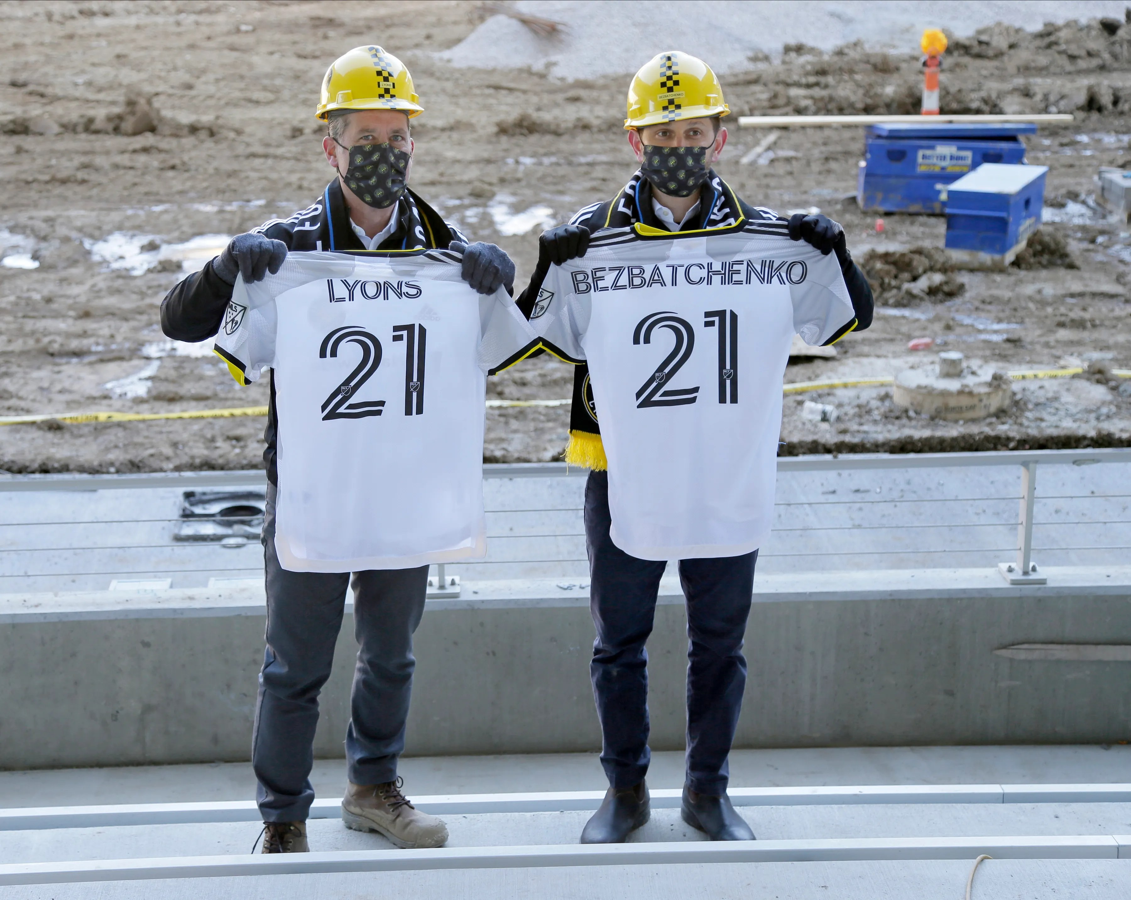 Tim Bezbatchenko, President and CEO of Crew SC, and Steve Lyons, Executive Vice President of Crew SC, Director of Business, pose with jerseys as Columbus Crew SC unveiled its main gear for the 2021 season at an event held at New Crew Stadium.