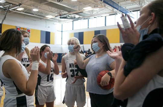 Feb. 27, 2021; Anthem, AZ, USA; North Valley Christian Academy's assistant coach, Sara Sauceda, (second from right) cheers at the girl's performance after the game at North Valley Christian Academy on Feb. 27, 2021. Credit: Meg Potter/The Arizona Republic