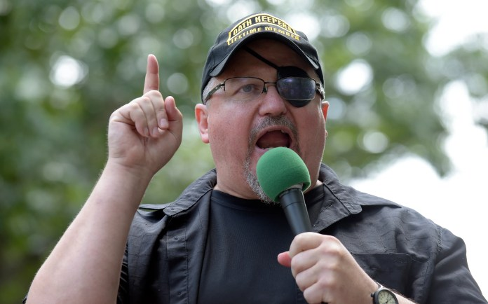 """In this Sunday, June 25, 2017, file photo, Stewart Rhodes, founder of the unauthorized militia group known as the Oath Keepers, speaks during a rally outside the White House in Washington. Rhodes, an Army veteran who founded the Oath Keepers in 2009 as a reaction to the election of President Barack Obama, said for weeks before the Jan. 6 Capitol riot that his group was preparing for a civil war and was """"armed, prepared to go in if the president calls us up."""""""