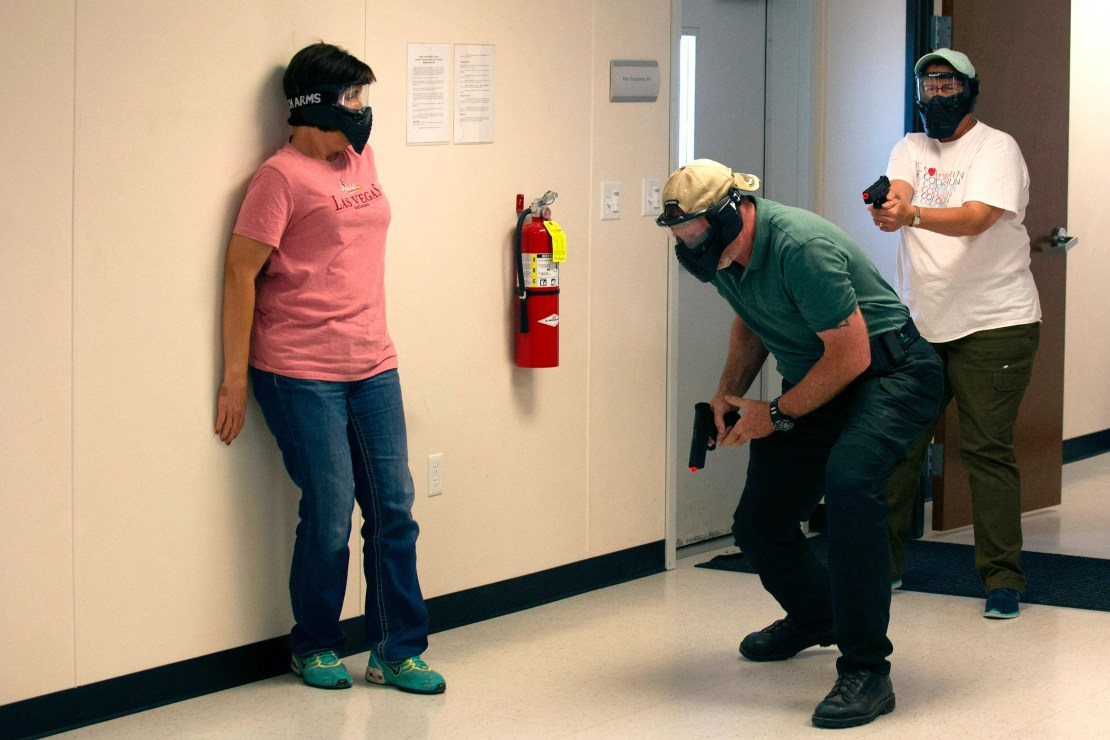 In this file photo taken on June 28, 2018 school teachers and administrators participate in an  Airsoft mock active shooter drill during a three day firearms course sponsored by FASTER Colorado at Flatrock Training Center in Commerce City, Colorado. When Donald Trump proposed arming teachers to deter school shooters, the overwhelming response from educators was horror. Yet teachers in Colorado are taking action to carry concealed guns to school. The non-profit group FASTER, set up after 20 small children were killed in 2012 at Sandy Hook Elementary School, has trained more than 1,300 US school staff, mostly in Ohio, on how to use a handgun in the event of a school shooting.