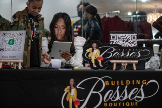 Renee Nesbitt, owner of Building Bosses Boutique talks to her daughter Makalyn Edward, 11, at her pop-up shop on the west side of Detroit on March 13, 2021.