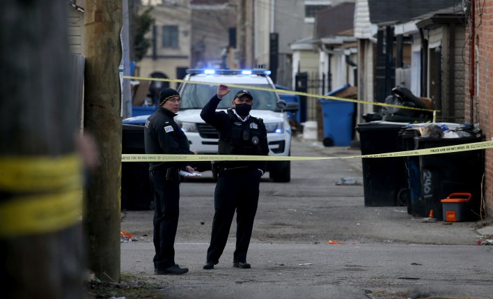 Police work at the scene of a fatal shooting of a 13-year-old boy by a Chicago Police officer on Monday, March 29, 2021 in Chicago.