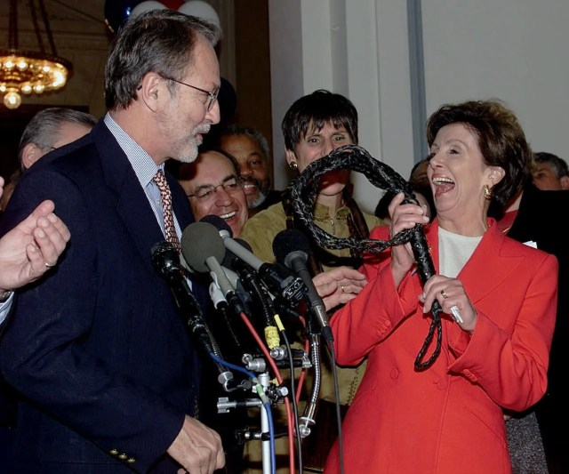 Outgoing House Whip David Bonior, D-Mich., presents newly elected Whip Nancy Pelosi, D-Calif., with a whip Wednesday Oct. 10, 2001, in Washington. Pelosi defeated Rep. Stenny Hoyer, D-Md., for the whip post in the House of Representatives.